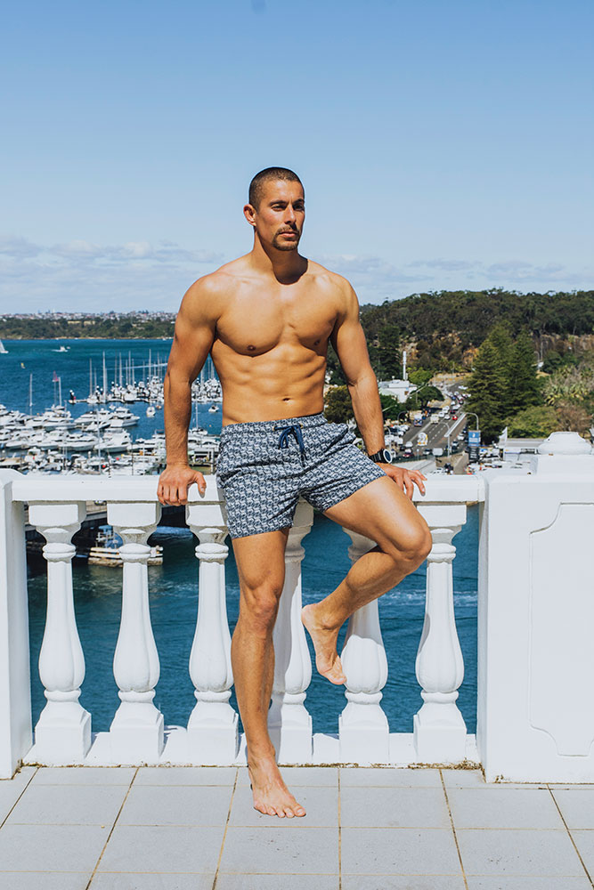 LAJOIE SKIN Antichafe cream Calmmé. Male athlete standing by the balcony at a waterfront property in Seaforth Calmmé protect the skin you're in.